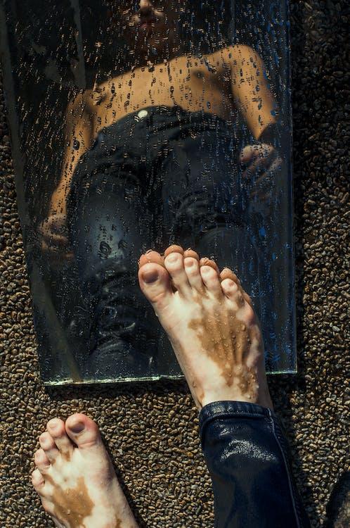 Reflection Photo of Man Wearing Black Pants