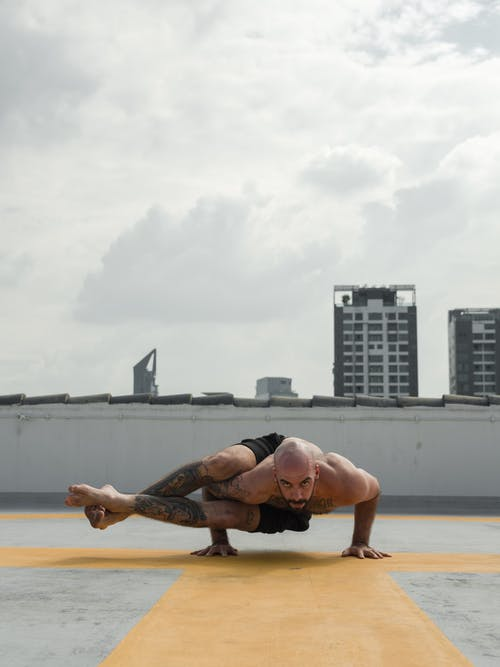 Photo of Man Doing Yoga Pose