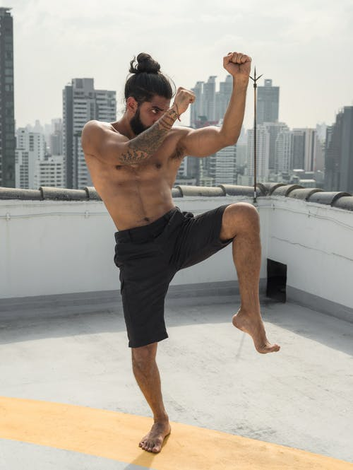 Man in Black Shorts While Doing Martial Art
