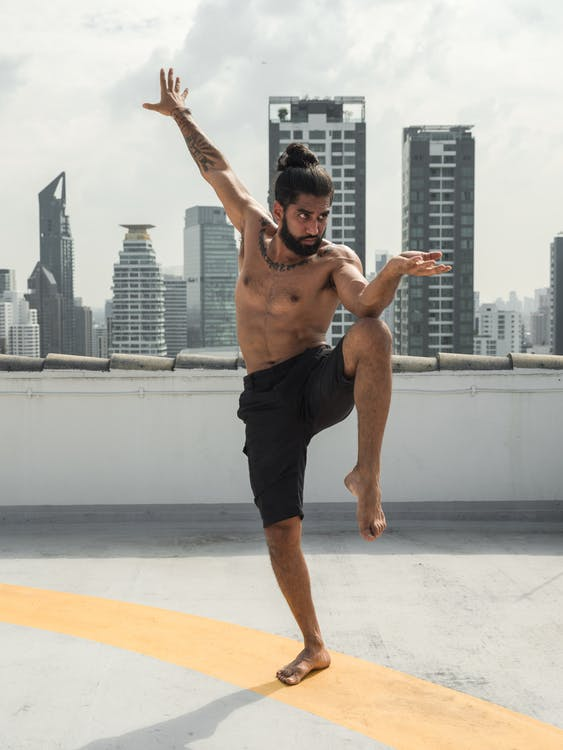 Man in Black Shorts Doing Martial Art