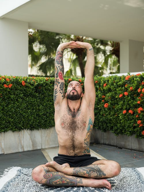Photo of Man Stretching