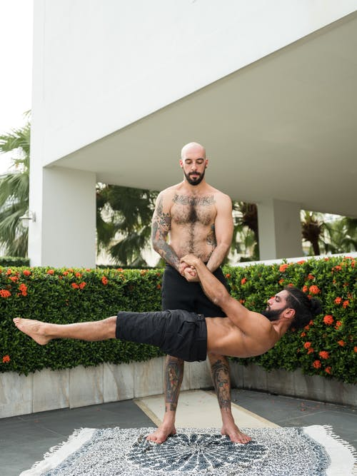 Photo of Two Men Doing Acrobatics