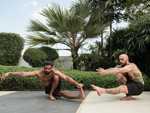 Photo of Two Men Exercising