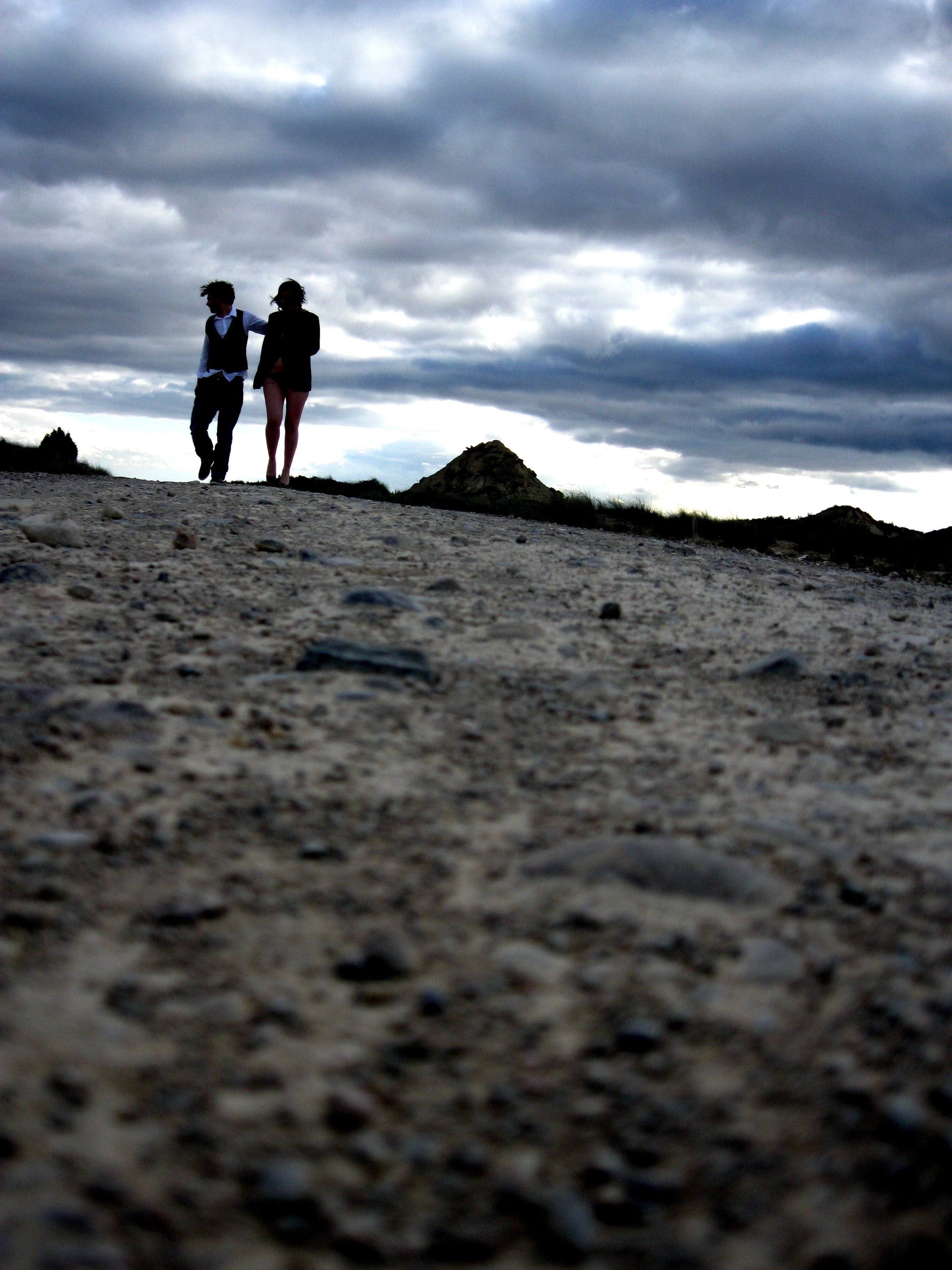 Silhouette Photography of Two Person Standing on Brown Soil