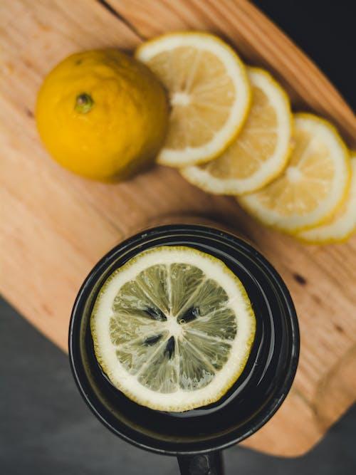 Sliced Lemon on Black Ceramic Plate