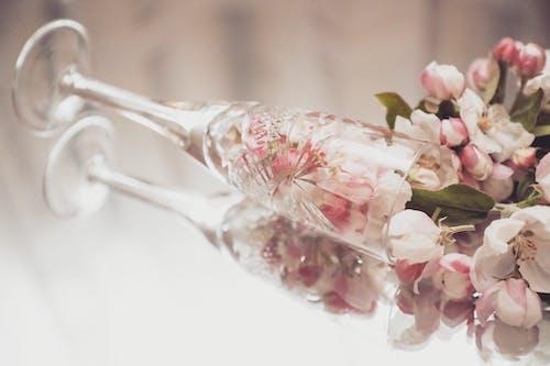 Bouquet of fresh cherry flowers in fallen glass