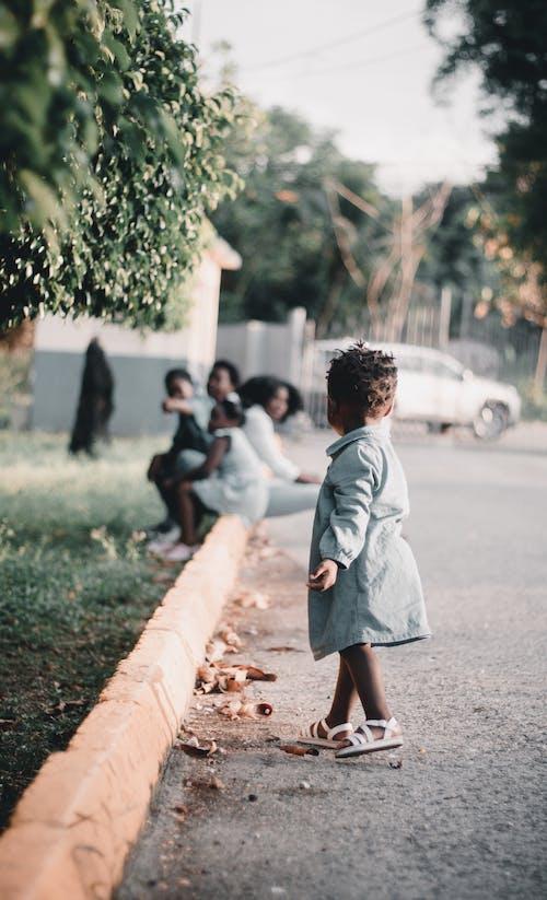 Girl in White Dress Walking on Pathway