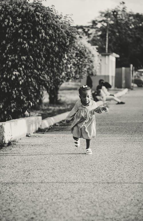Boy in Gray Coat Walking on the Street