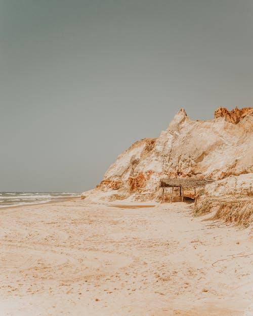 Rocky rough cliffs near sandy beach