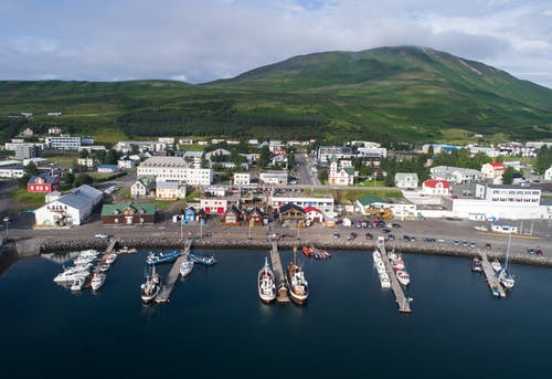 Amazing view of Husavik harbor in Iceland in summertime