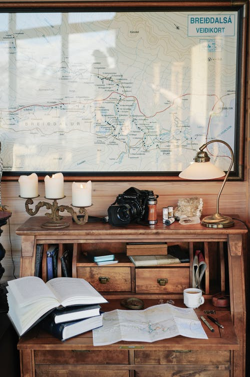 Vintage interior with old fashioned wooden desk and big map