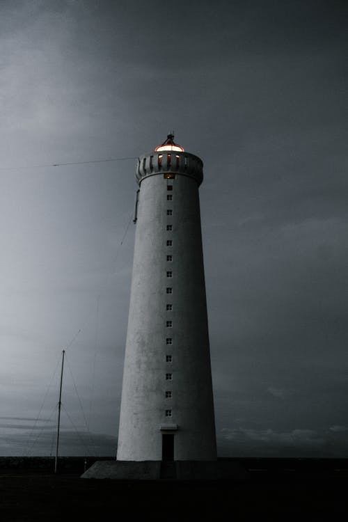 Lighthouse tower in gloomy dark day