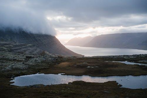 Imagine de stoc gratuită din acoperit de nori, apă, apus, apus de soare