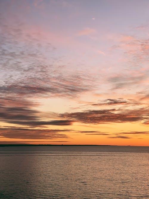 Cloudy sky over calm rippling sea
