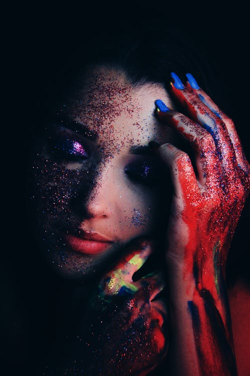 Tender woman with painted arms and shiny makeup