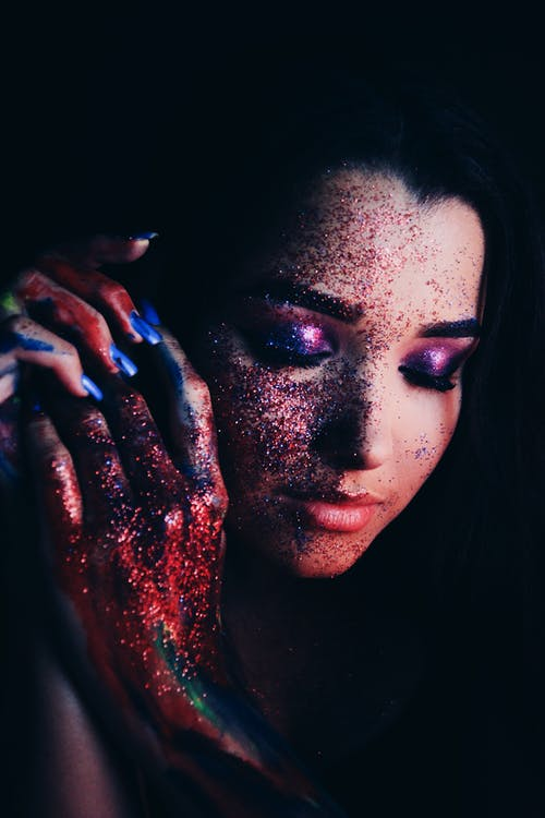 Sensual woman with bright glitter makeup