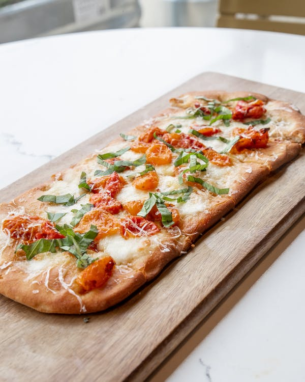 Delicious pizza with tomato cheese and herbs