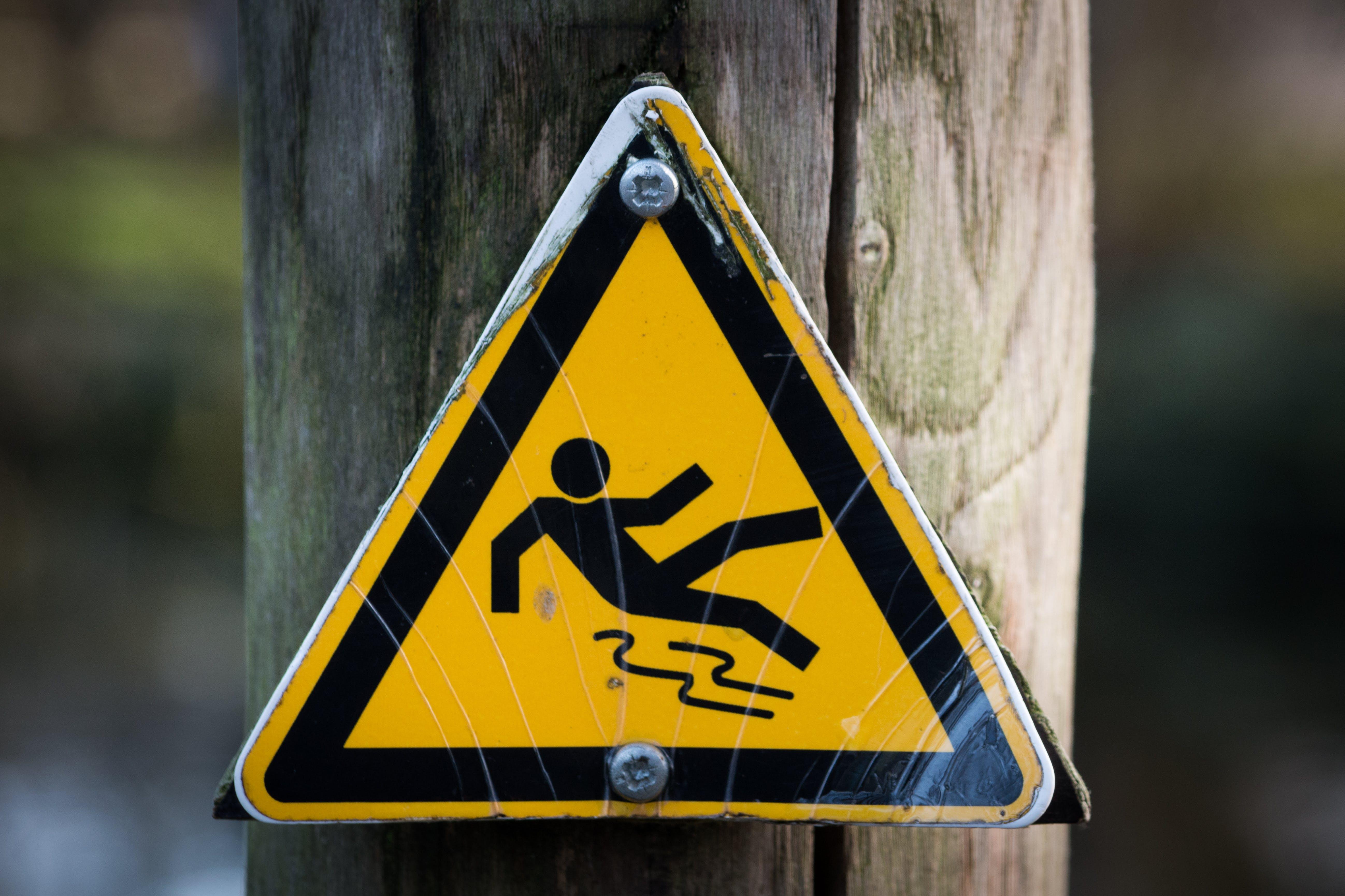 Yellow Slippery Road Signage