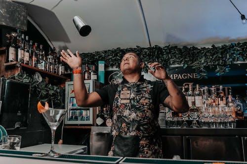 Bartender preparing cocktail in modern pub