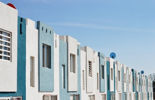White and Teal Concrete Buildings