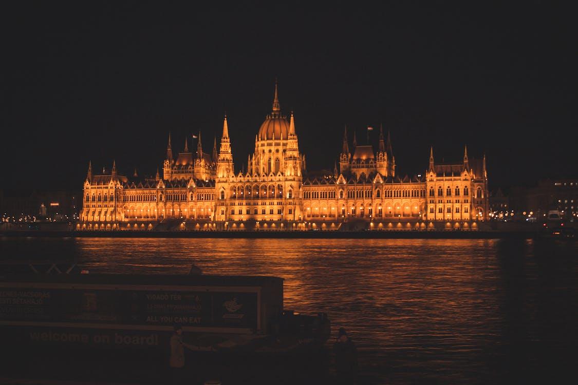 Majestic palace building glowing at night