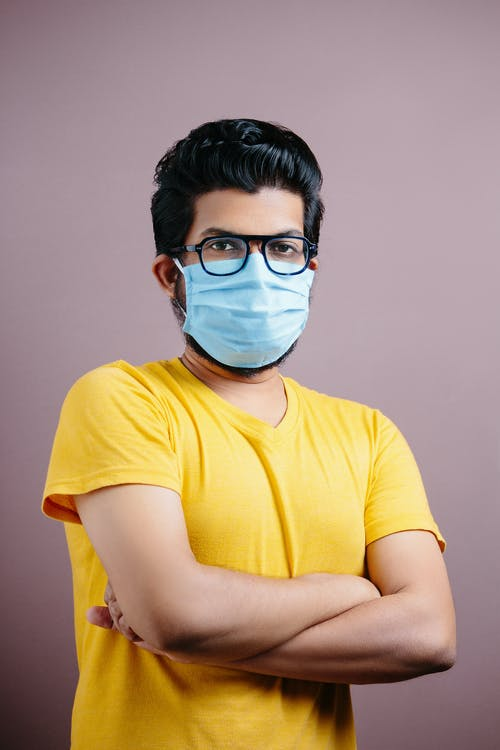 Man in Yellow Crew Neck T-shirt Wearing White Face Mask