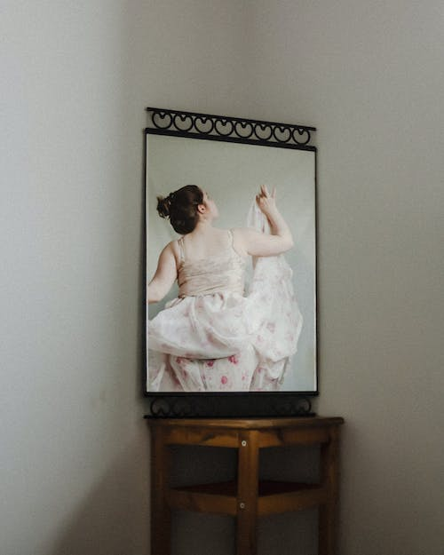 Mirror reflection of woman in dress
