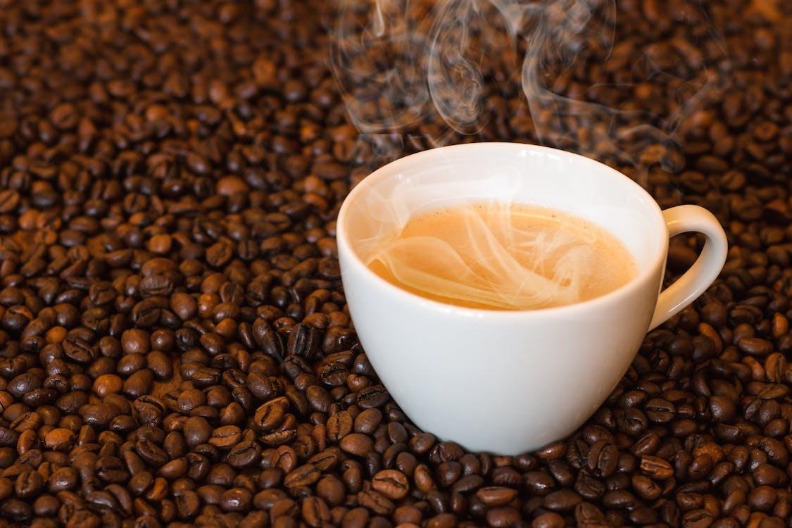White Ceramic Teacup on Coffee Beans