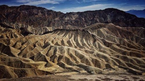 Kostnadsfri bild av berg, blå himmel, dödsdalen nationalpark, gyllene sol
