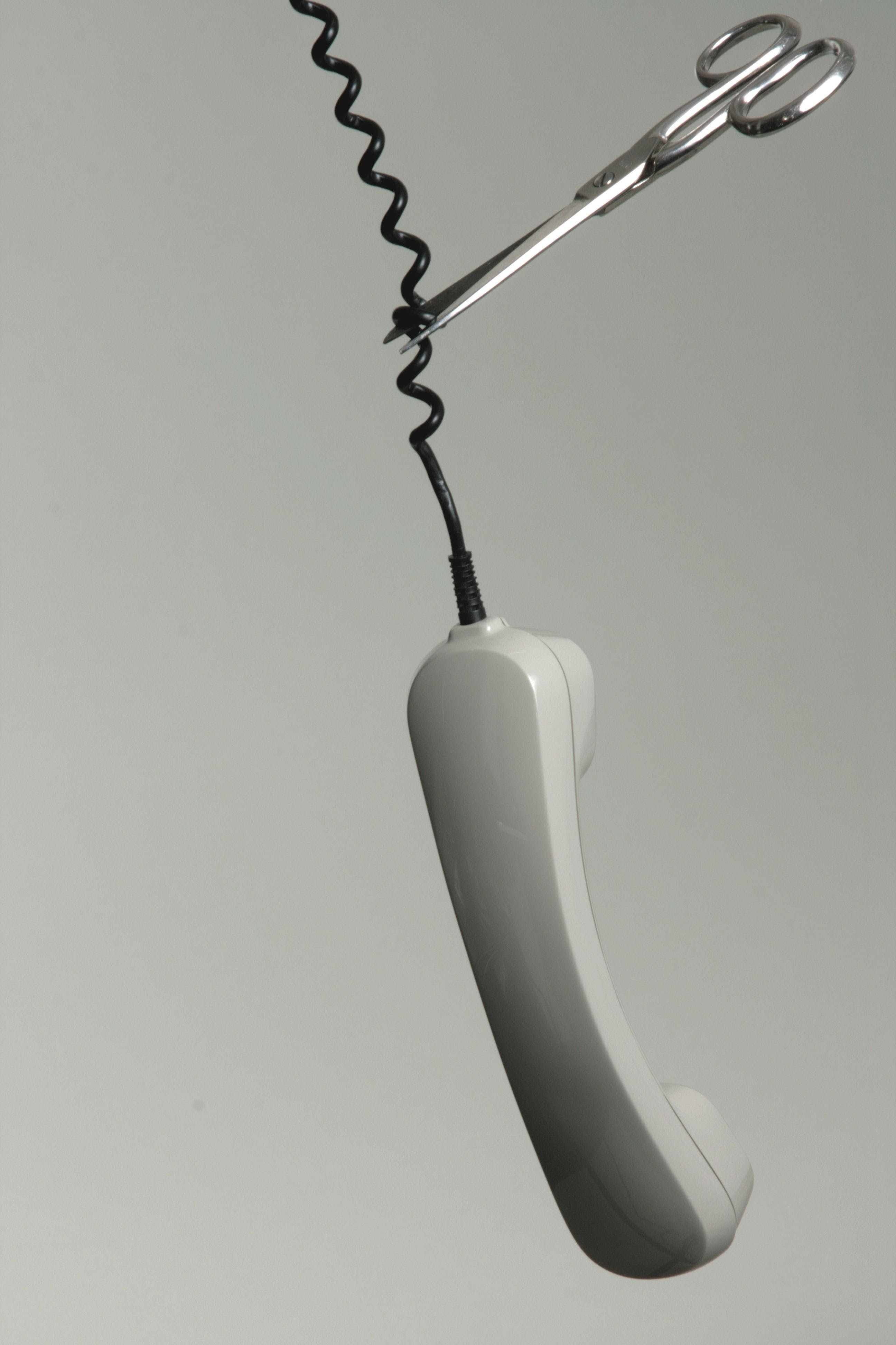 Scissor Cutting Telephone's Trim Line