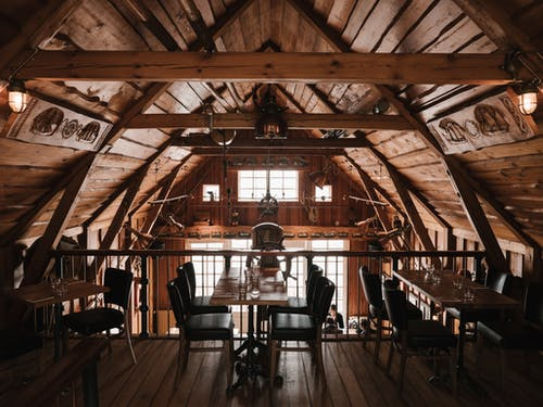 Spacious wooden interior of modern cafe decorated in style of old marine vessel