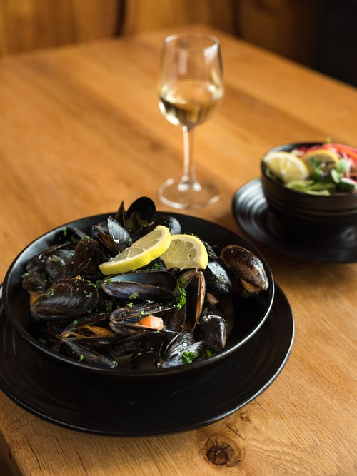 Delicious seafood served with glass of wine