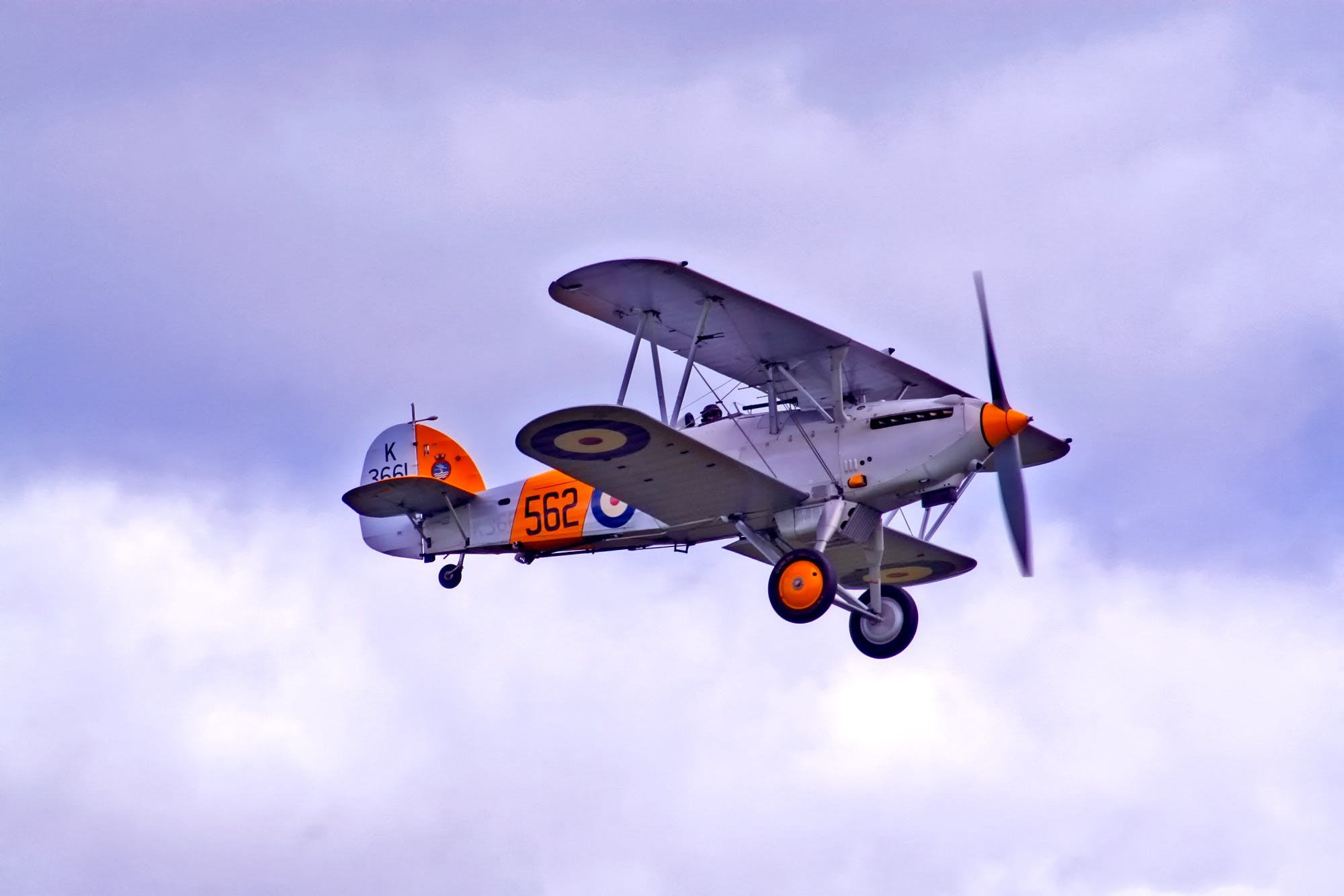 White and Orange Biplane