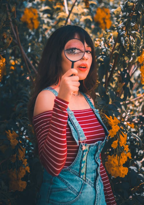 Woman in Red and White Striped Tank Top and Blue Denim Vest Wearing Black Framed Eyeglasses