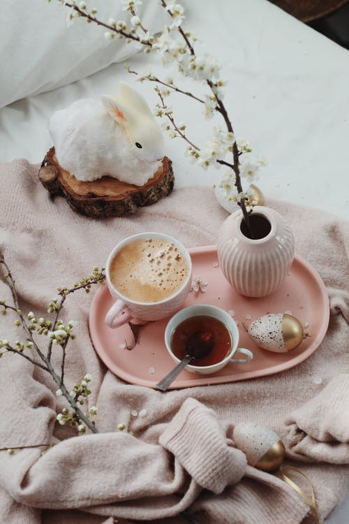 Fresh beverages and Easter composition on bed
