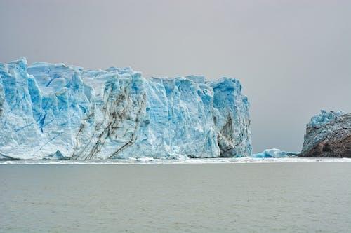 Rough rocky glacier in sea