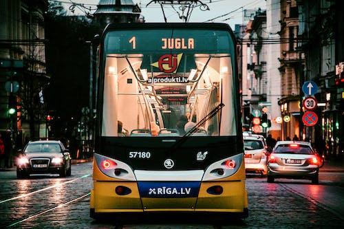 Modern trolleybus in city in evening