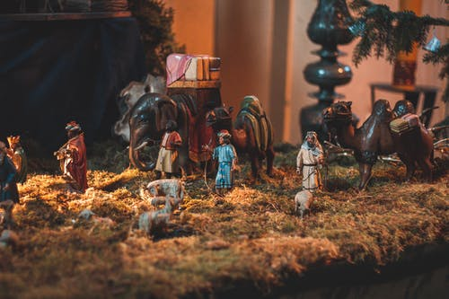 Nativity scene with miniature figurines of people demonstrating Birth of Christ placed in church