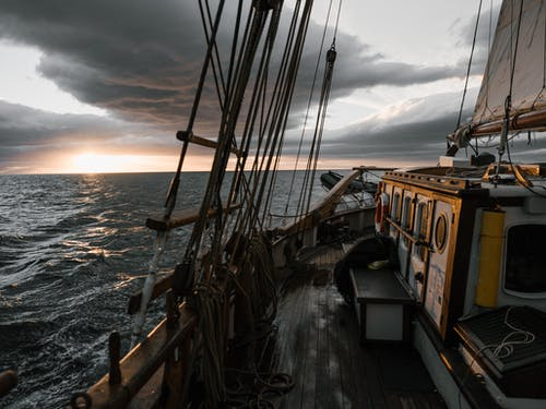 Ship sailing in sea during magnificent sunset