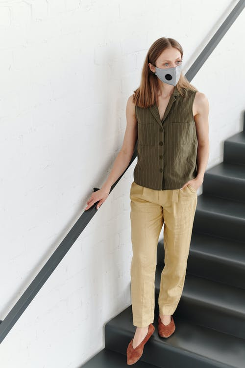 Woman With a Face Mask on Stairs