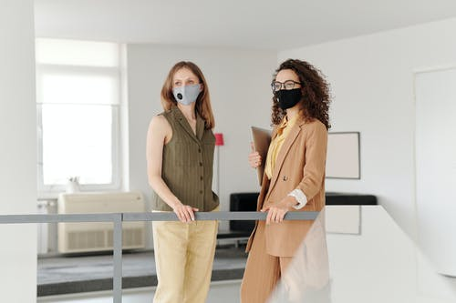 Business Women Wearing Face Masks