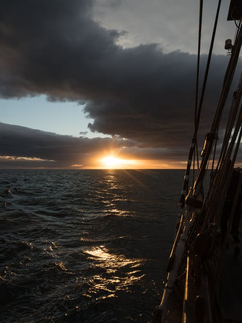 View of beautiful seascape and sunset from sailing boat