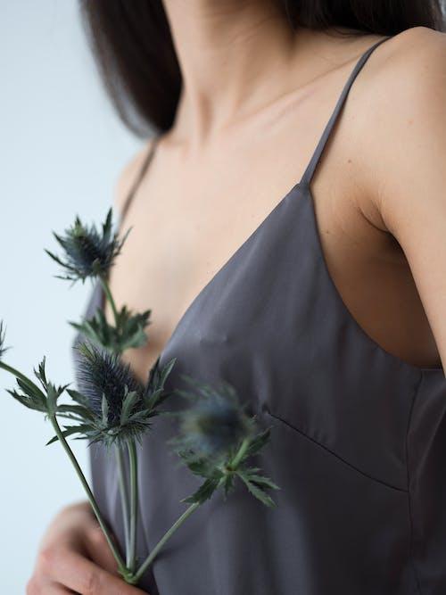 Crop tender lady with natural Eryngium flowers