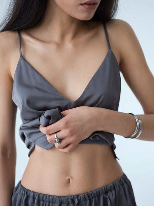 Crop confident young woman with prefect body shape