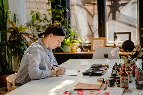 Photo of Woman Doing Lettering