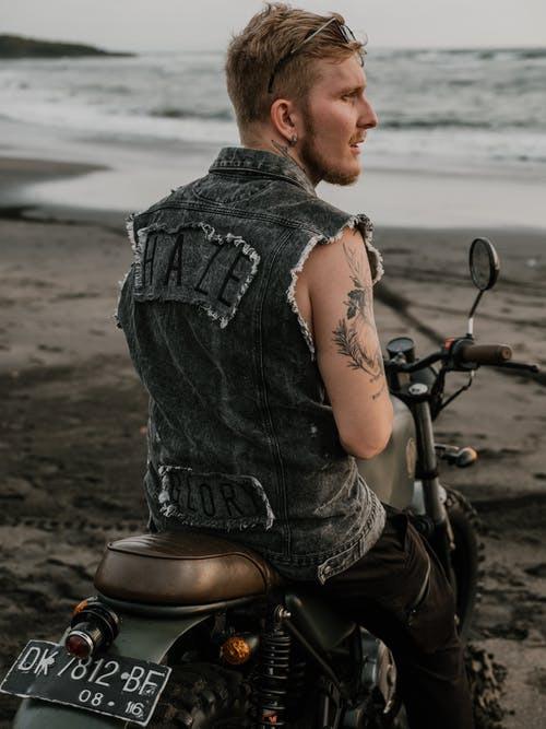 Photo of Man Sitting on His Motorcycle