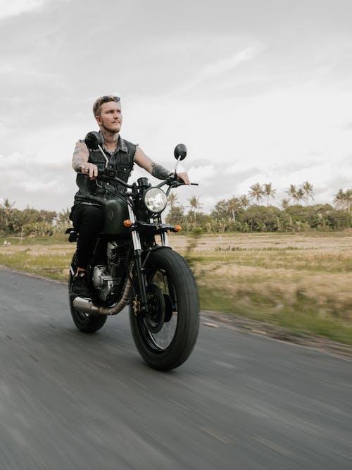 Man Riding Black Motorcycle on Road