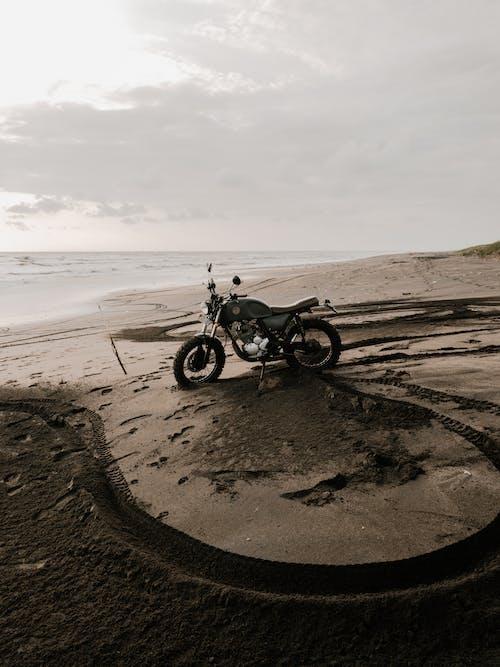 Black Motorcycle on Seashore