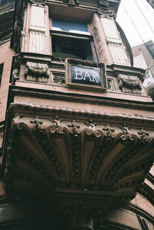 Facade of old building with BAR inscription in daylight
