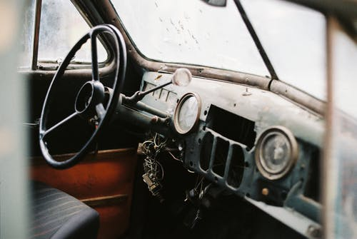 Interior of retro car with speedometer and steering wheel